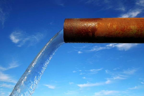 Liquid waste flowing out a pipe | track it via liquid waste management software